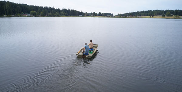 Mark Sytsma and Matt Zupich in a boat on Lone Lake